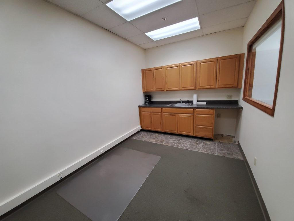 office across from the main entrance which includes a kitchenette